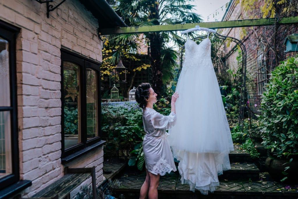 bride admiring her wedding dress
