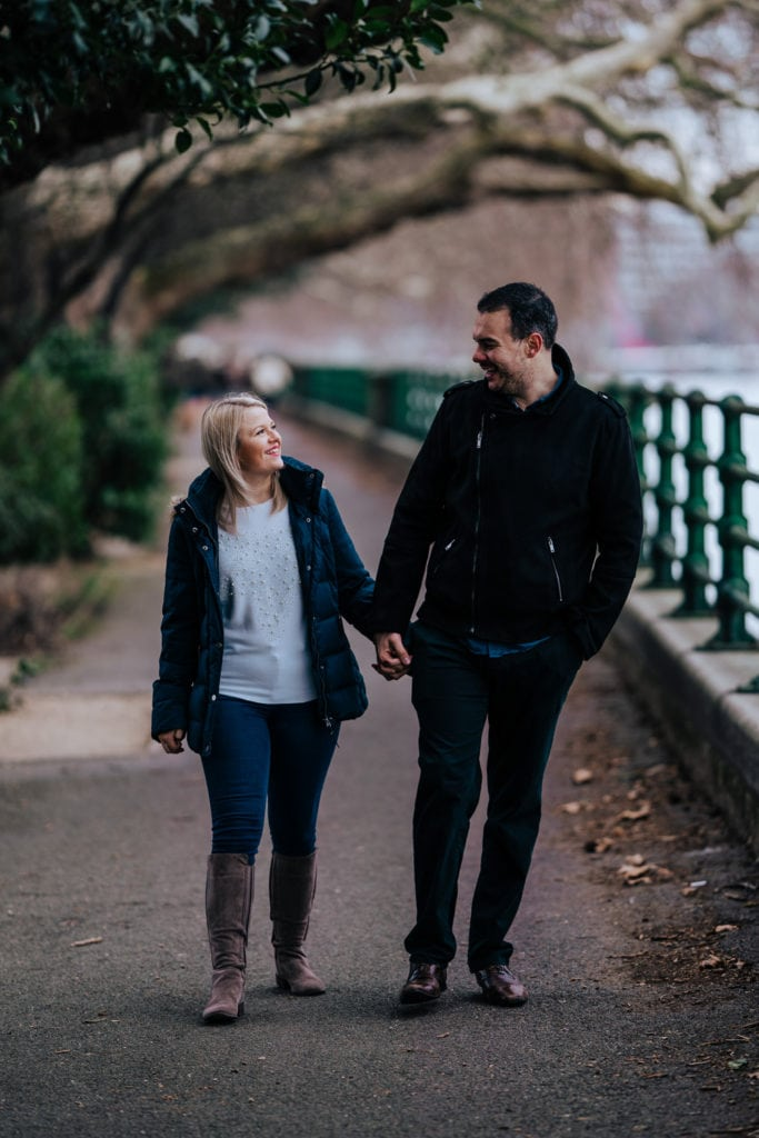 A young couple pose during engagement shoot shot in Fulham FC
