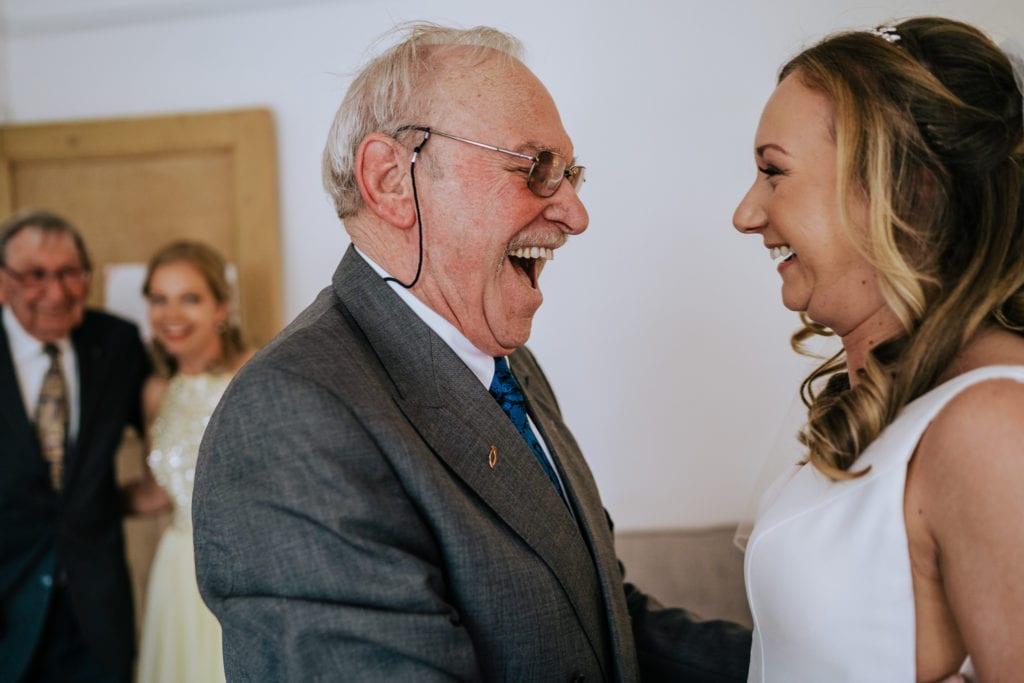 bride greets grandad during bridal prep