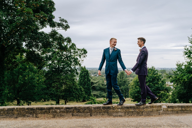 gay couple walking through Pembroke Lodge wedding venue