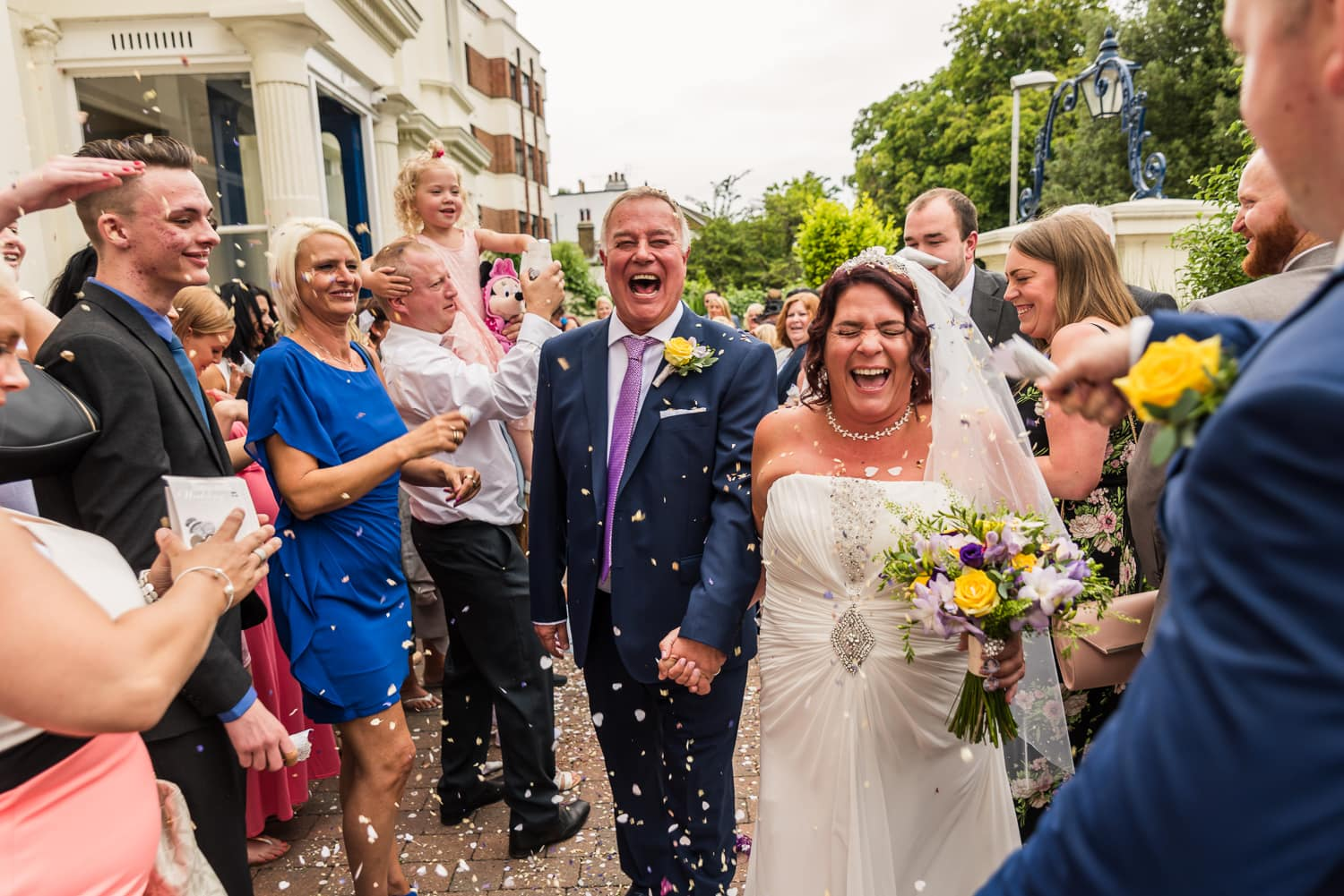 newlyweds celebrating with confetti after beautiful ceremony