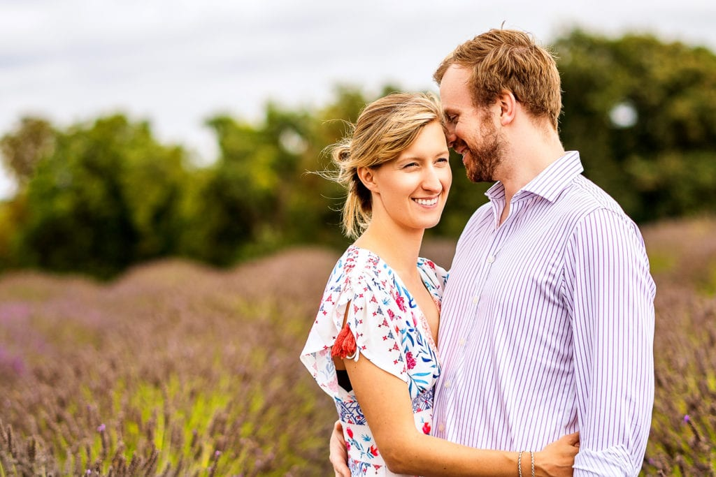 A beautiful pre wed picture taken in the picturesque Mayfield Lavender farm surrounded by stunning colours by Alex Buckland Photography