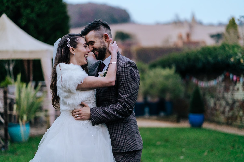 Fun candid photo of Bride and groom at Kings Chapel Amersham Wedding Venue