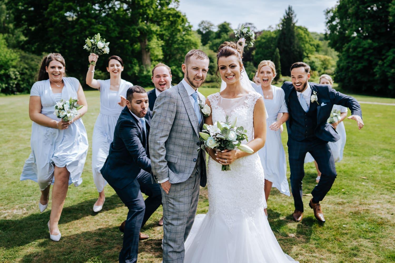 Bridal party surprising Bride and Groom