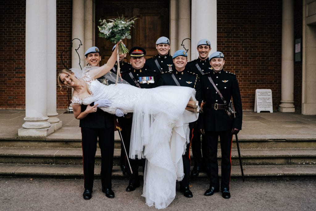 bride carried by guard of honour