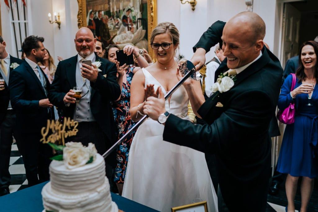 bride and groom cut cake military wedding