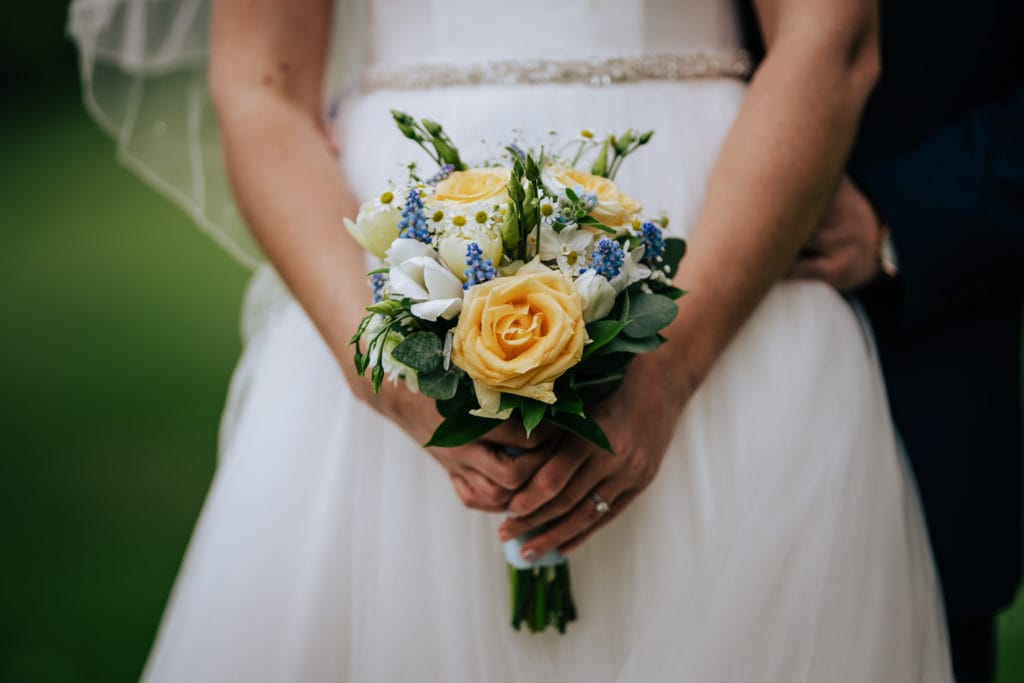 bride holding bouquet during wiltshire wedding