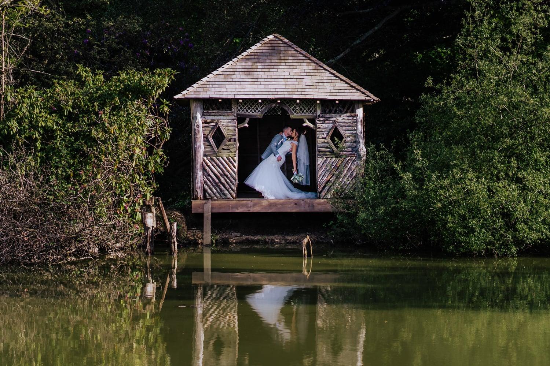 groom dips bride in stunning wedding photo