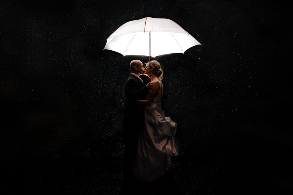 bride and groom creative night portrait in the rain