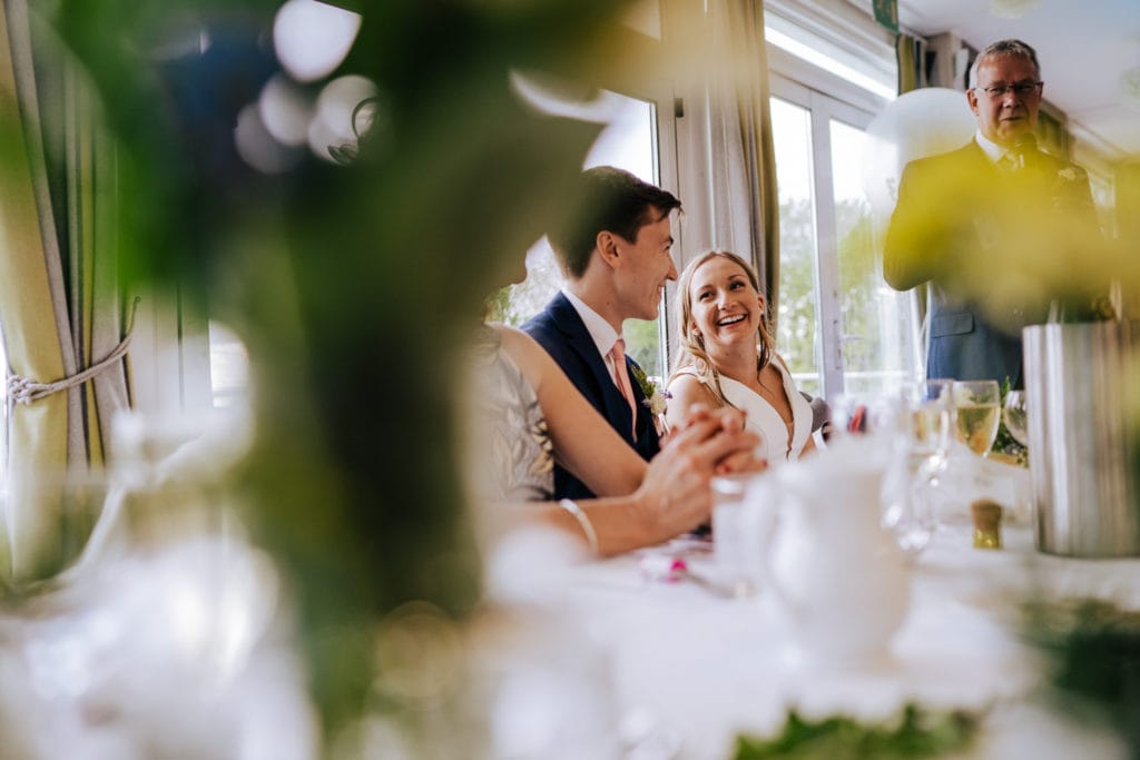 candid shot of bride during intimate wedding speeches