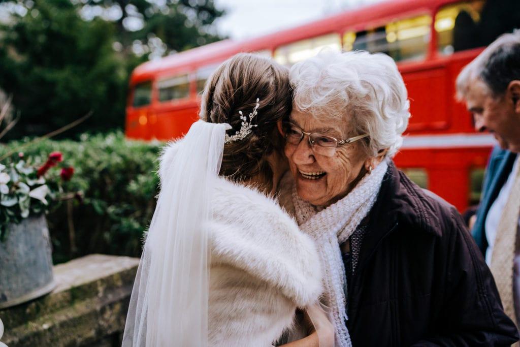 Reception line Grandma greets Bride at reception