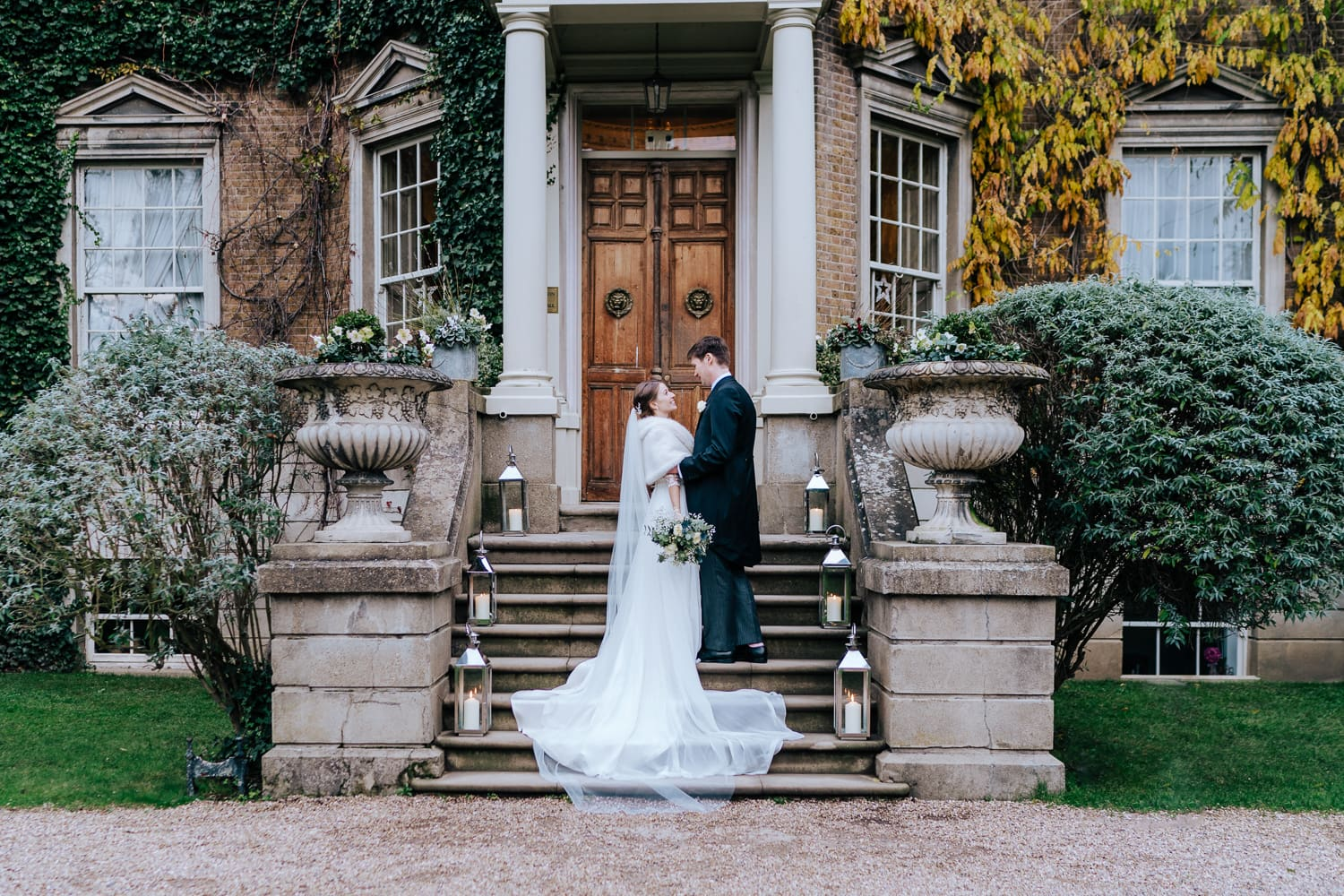 intimate portrait of bride and groom at Hampton Court House