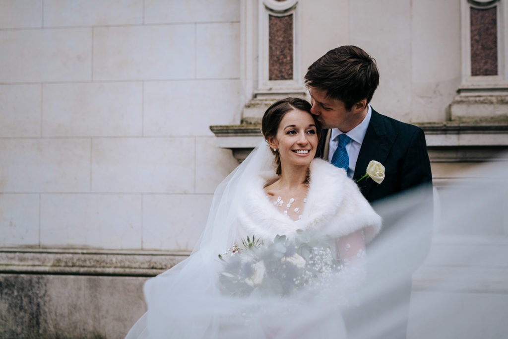 Stylish wedding portrait of bride and groom at Surrey wedding