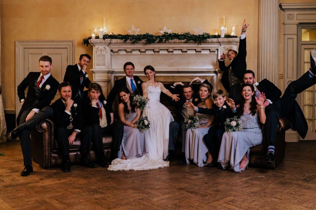 fun stylish group photo at Hampton Court Hose Wedding | Surrey wedding photographer