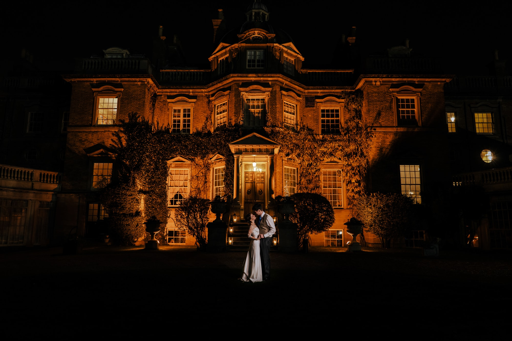 couple pose in front of surrey wedding venue