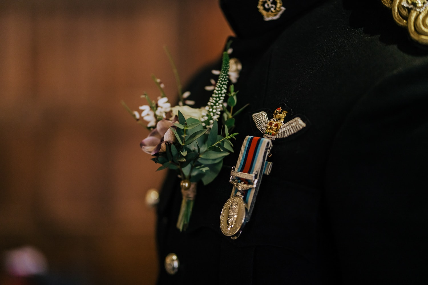 boutonniere next medal on military wedding uniform