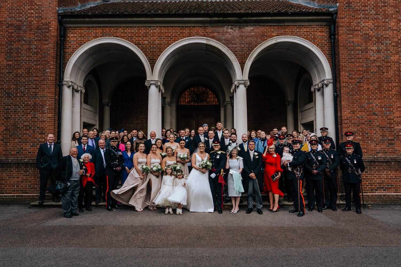group photo outside Royal Memorial Chapel at RMAS Sandhurst
