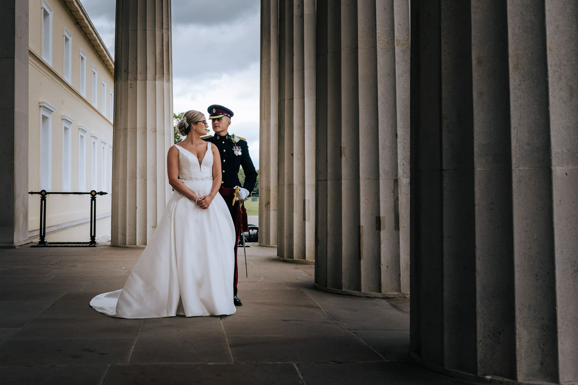 military wedding photographer captures Bride and groom on old college steps RMAS
