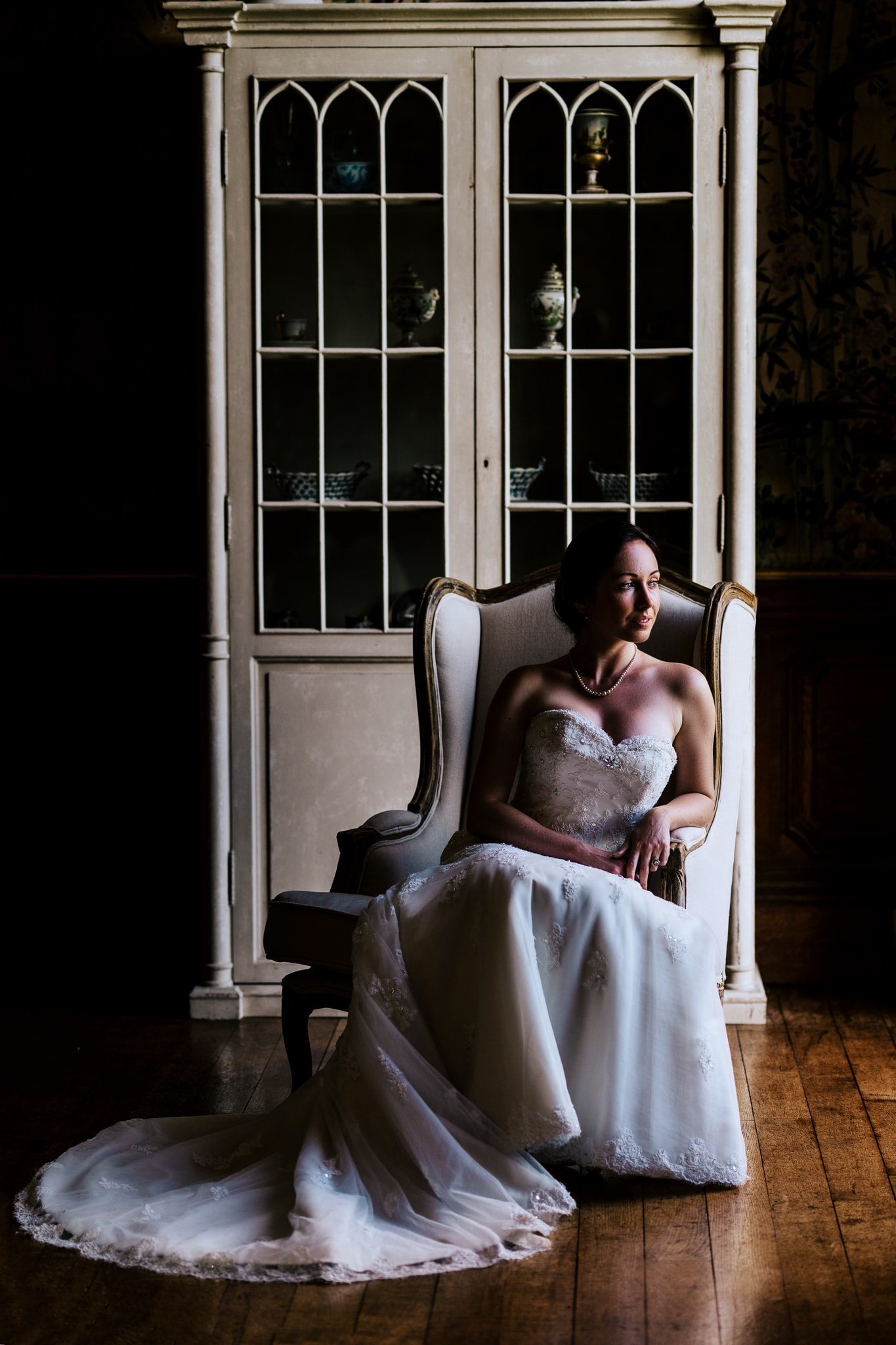 bride getting ready in natural light window portrait