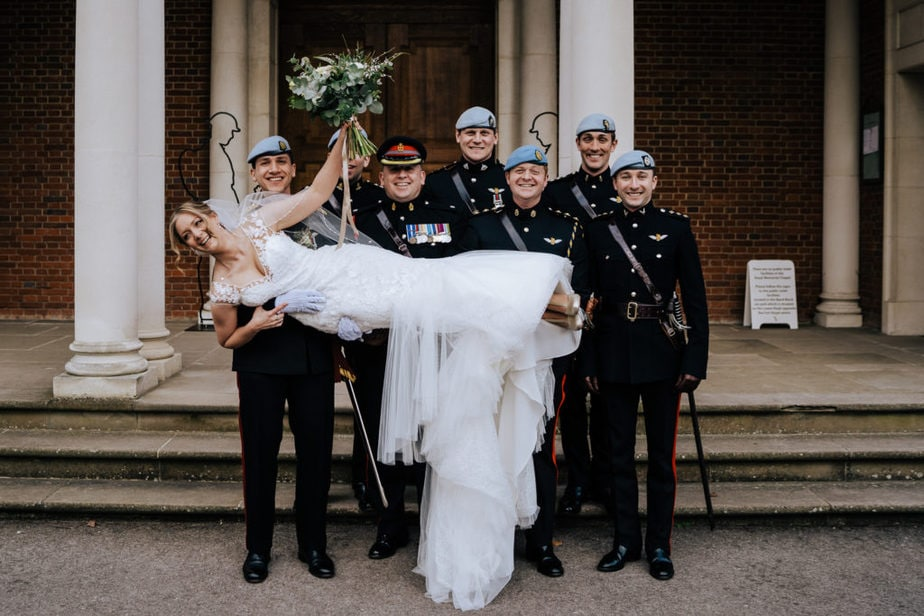 bride lifted up by military guard of honour