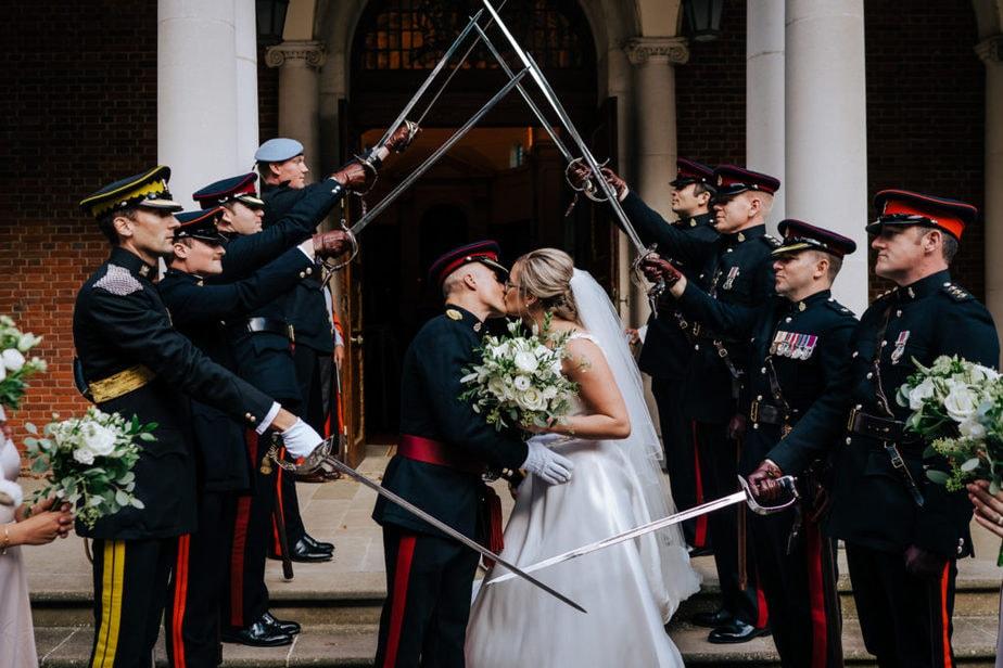 Bride and groom kiss under guard of honour at RMAS Sandhurst