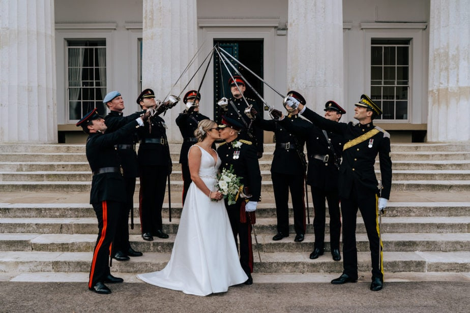 Guard of honour surrounding Bride and groom on Old College Steps Sandhurst