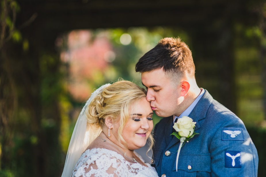 intimate portrait of RAF airmen and his bride during couples portraits