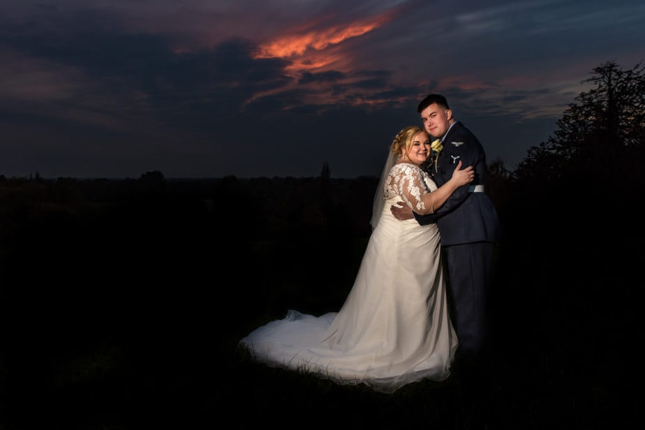 sunset portrait of RAF military wedding couple at Richmond Hill Hotel