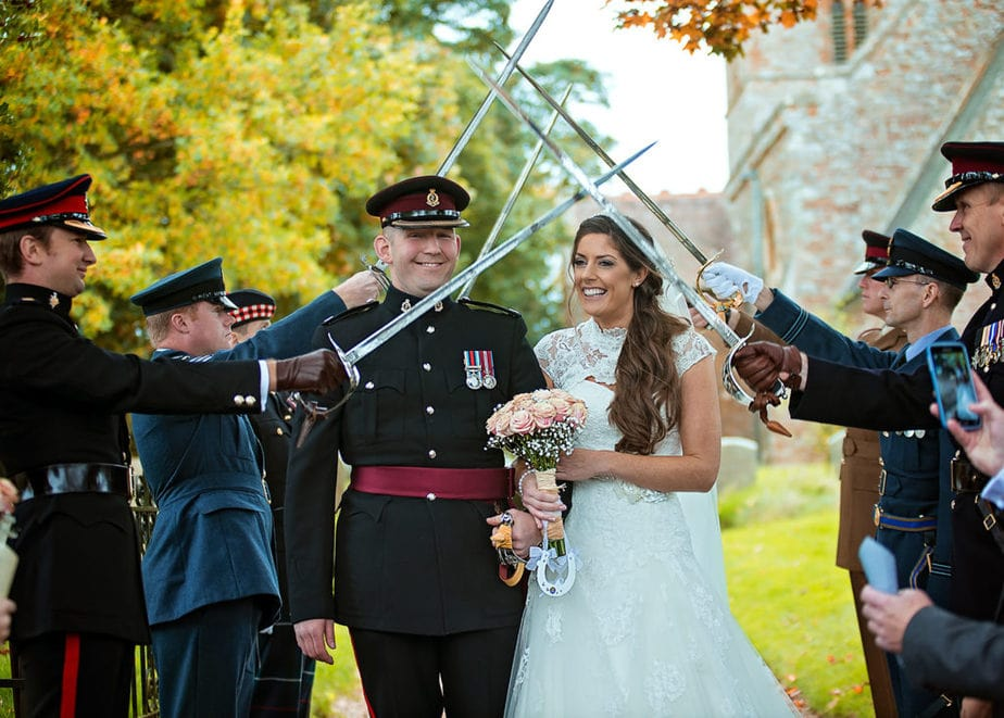army wedding couple having fun with guests after ceremony