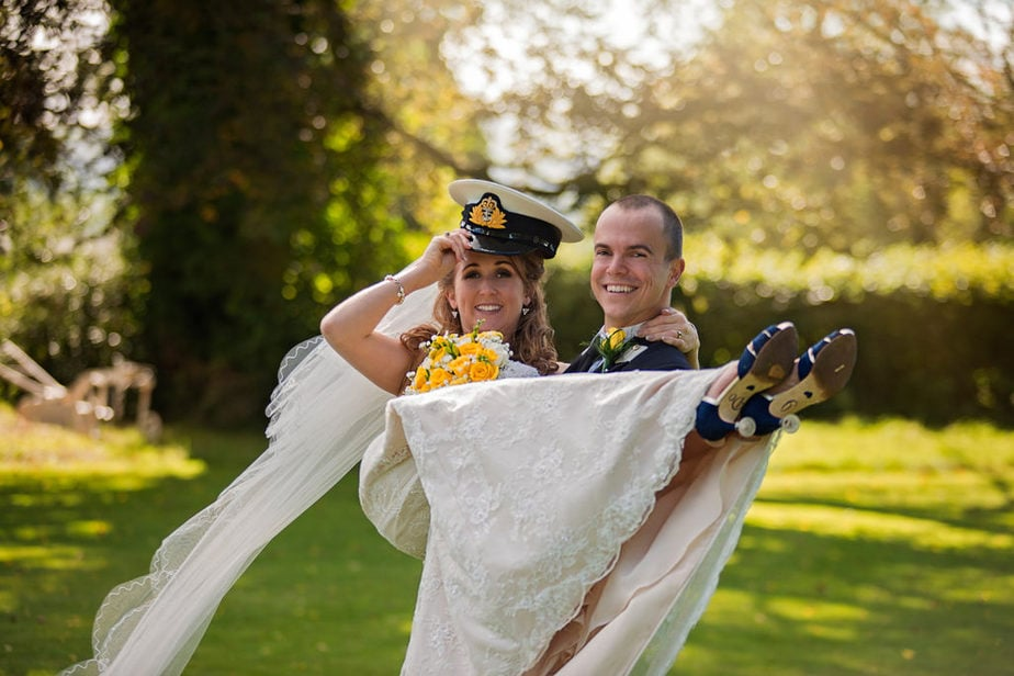 an officer and his lady at posh UK wedding