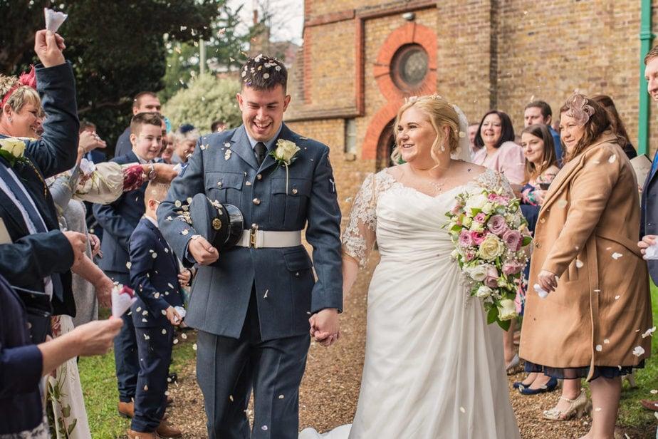RAF military wedding couple exit church into aisle of confetti