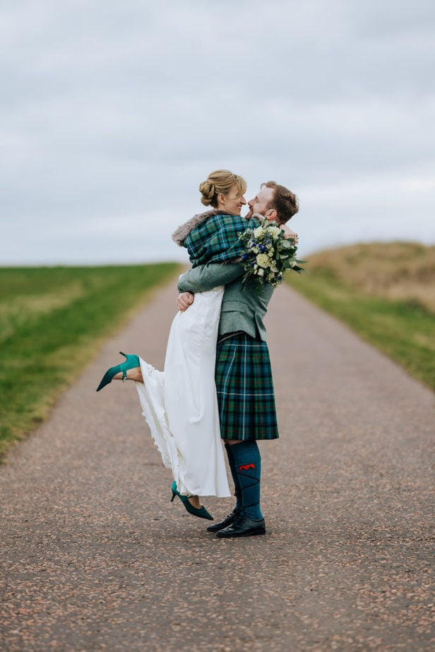 fun intimate candid portrait of bride and groom captured by award winning surrey wedding photographer