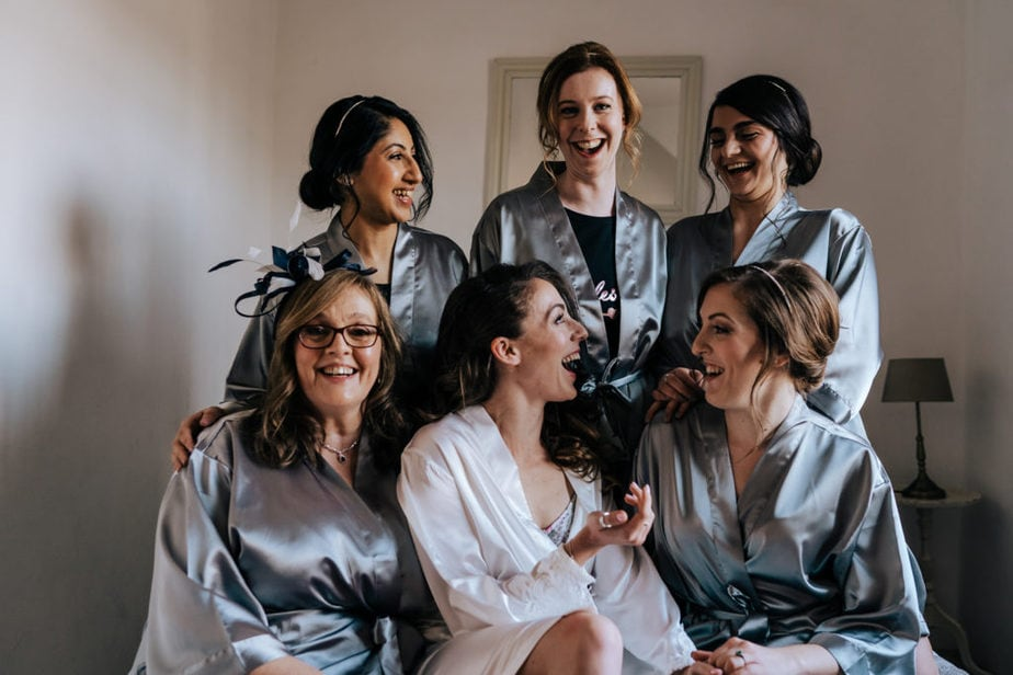 surrey bride and bridesmaids laughing during group photos