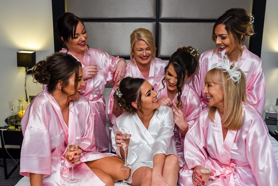 bride celebrating with bridesmaids and Mum before wedding ceremony