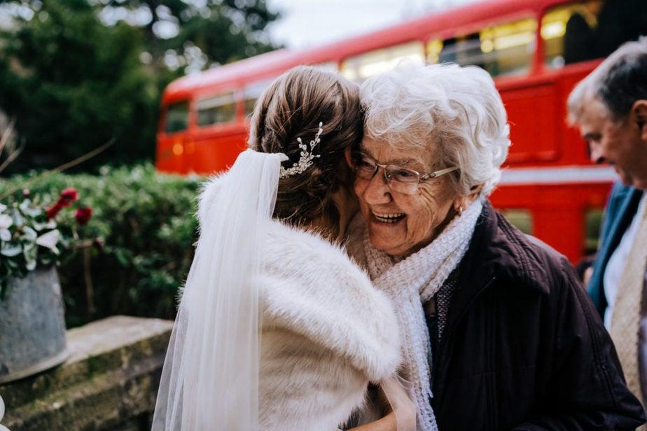 gran hugs bride at surrey wedding